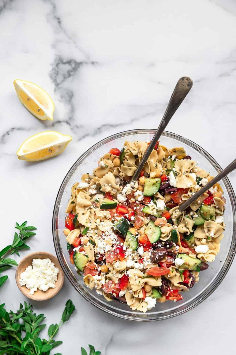 """<p>If you want a meal that'll fill you up, try this chickpea pasta salad. Made complete with rich feta, crunchy cucumbers, juicy tomatoes, salty olives, and a tangy lemon dressing, this salad is too good to be true. Serve it cold for best results.</p> <p><strong>Get the recipe:</strong> <a href=""""https://www.foodfaithfitness.com/mediterranean-chickpea-pasta-salad/"""" class=""""link rapid-noclick-resp"""" rel=""""nofollow noopener"""" target=""""_blank"""" data-ylk=""""slk:Mediterranean chickpea pasta salad"""">Mediterranean chickpea pasta salad</a></p>"""