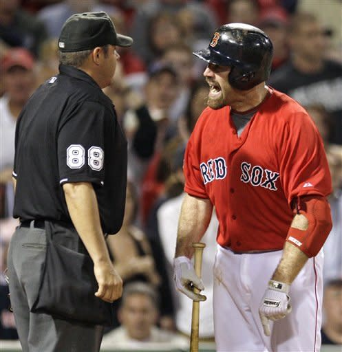 Boston Red Sox' Kevin Youkilis argues with home plate umpire Doug Eddings after being called out looking with the bases loaded against the Washington Nationals in the sixth inning of a baseball game at Fenway Park, Friday, June 8, 2012, in Boston. Youkilis was ejected during the argument. (AP Photo/Charles Krupa)