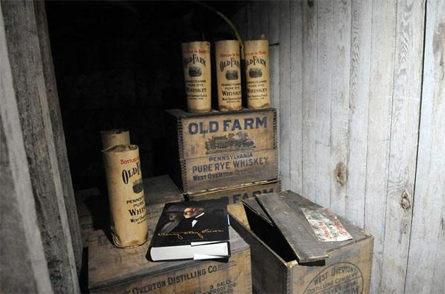 Bottles of Old Farm whiskey at South Broadway Manor Bed and Breakfast. (Sean Stipp/Tribune-Review)