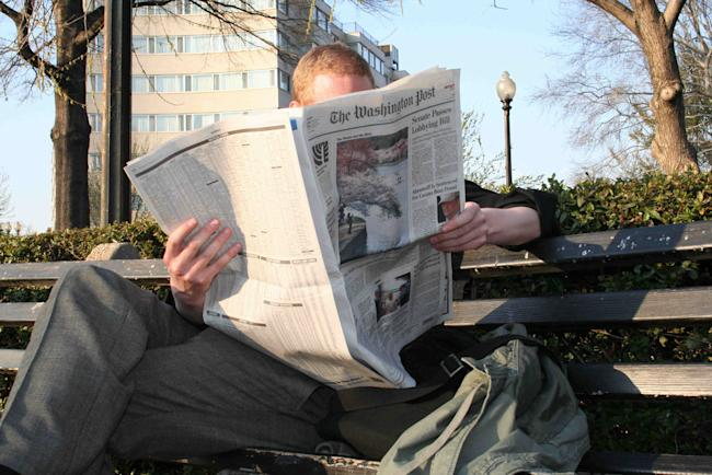 reading newspaper washington dc