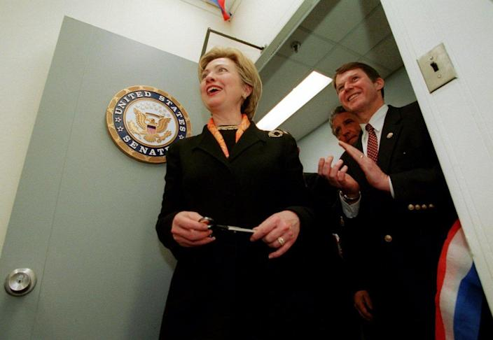 <p>Sen. Hillary Clinton gets a first look at her new office in Albany, N.Y., Monday, Jan. 8, 2001. Clapping behind Clinton is Rep. Mike McNulty. (Photo: Will Waldron/AP)</p>