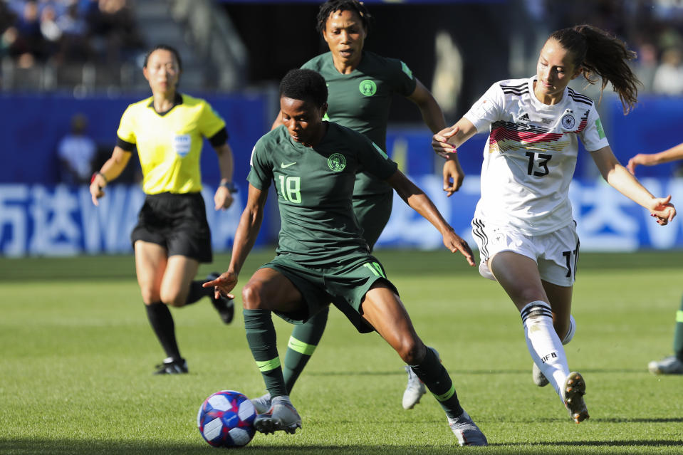 Nigeria's Halimatu Ayinde, left, vies for the ball with Germany's Sara Daebritz during the Women's World Cup round of 16 soccer match between Germany and Nigeria at Stade del Alpes in Grenoble, France, Saturday, June 22, 2019. Daebritz scored once in Germany's 3-0 victory. (AP Photo/Laurent Cipriani)