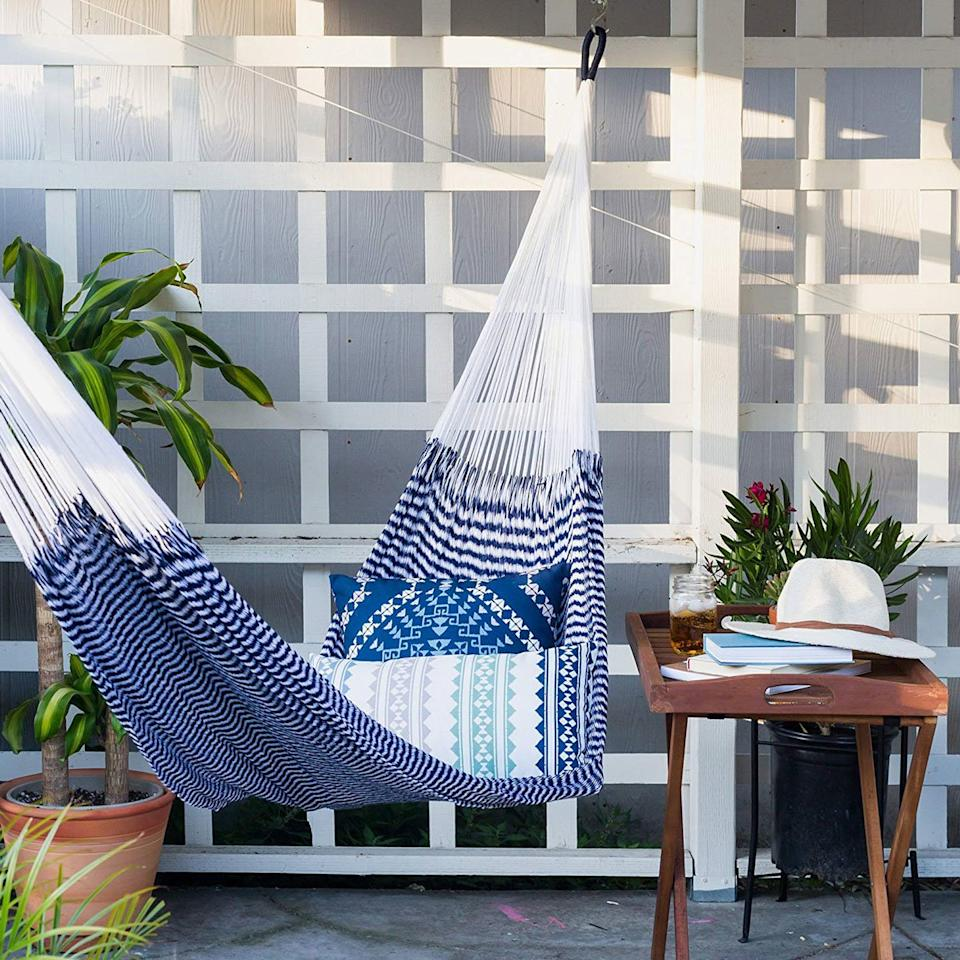 "<p>Nothing says laid back like settling into a hammock, and there's no better way to elevate your <a href=""https://www.foodandwine.com/slideshows/labor-day-bbq"" target=""_blank"">barbecue</a> that by stringing one up beside the patio table and chairs.</p> <p><em>Yellow Leaf Outdoor or Indoor Hammock, $199 at <a href=""https://www.amazon.com/Yellow-Leaf-Hammocks-TJ-Vineyard-Haven-Weathersafe/dp/B00CPZ93AQ/ref=as_li_ss_tl?ie=UTF8&linkCode=ll1&tag=fwbackyardbbqfallcookout0819-20&linkId=2e04cc259ee374b6adccbb863ea60640&language=en_US"" target=""_blank"">amazon.com</a></em></p> <p> <a href=""https://www.foodandwine.com/lifestyle/outdoor-bars-amazon"">10 Great Outdoor Bars You Can Buy From Amazon</a></p>"