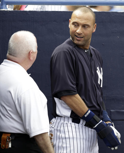 FILE - In this March 9, 2013, file photo, New York Yankees shortstop Derek Jeter talks with trainer Steve Donohue after batting as the designated hitter in a spring training baseball game against the Altanta Braves in Tampa, Fla. The Yankees said Thursday, April 18, 2013, that Jeter will be sidelined until after the All-Star break because of a new fracture in his injured left ankle. (AP Photo/Kathy Willens, File)