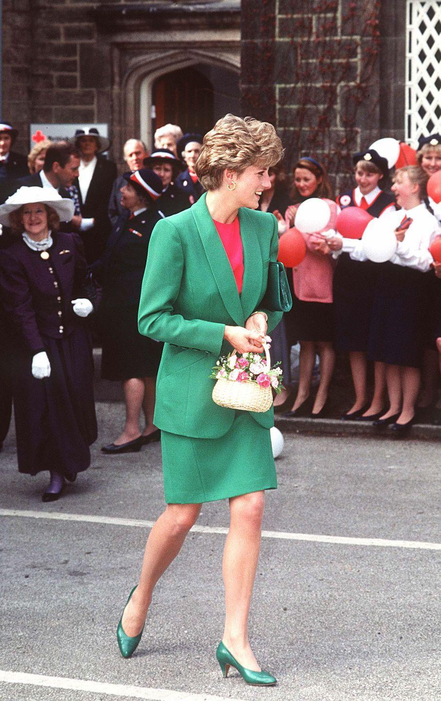 <p>A pink and green moment is so very T&C. Diana wore this chic tonal suit during a visit to Babington Hospital in April 1992.<br></p>