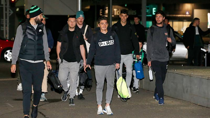 A-League players are seen here ready to fly out of Melbourne.