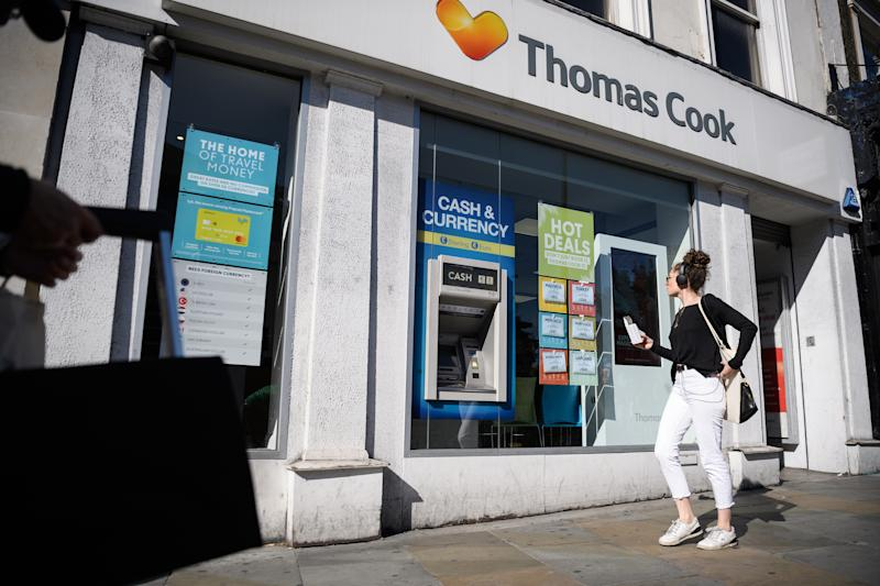 LONDON, ENGLAND - SEPTEMBER 20: Shoppers walk past a branch of travel agent chain Thomas Cook on September 20, 2019 in London, England. Banks are insisting that the company finds £200m more in extra contingency funds, or it faces the prospect of falling into administration. If the company does collapse, around 150,000 holiday-makers would need to be repatriated from their current locations. (Photo by Leon Neal/Getty Images)