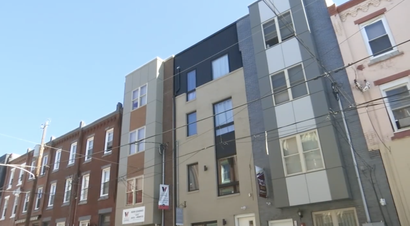 A still of the Pennsylvania apartment building where students fell from the rooftop.