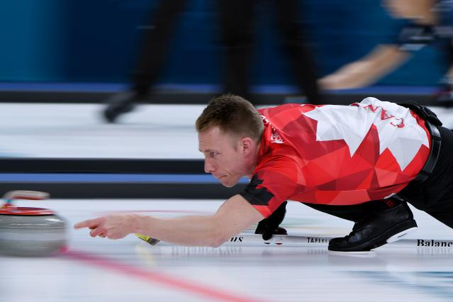 <p>Canada's Marc Kennedy throws the stone during the curling men's round robin session between Canada and Sweden during the Pyeongchang 2018 Winter Olympic Games at the Gangneung Curling Centre in Gangneung on February 17, 2018 </p>