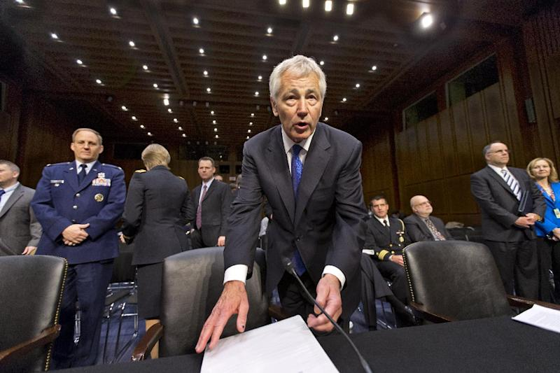 Defense Secretary Chuck Hagel arrives on Capitol Hill in Washington, Wednesday, April 17, 2013, to testify before the Senate Armed Services Committee hearing on the Pentagon's budget for fiscal 2014 and beyond.  (AP Photo/J. Scott Applewhite)