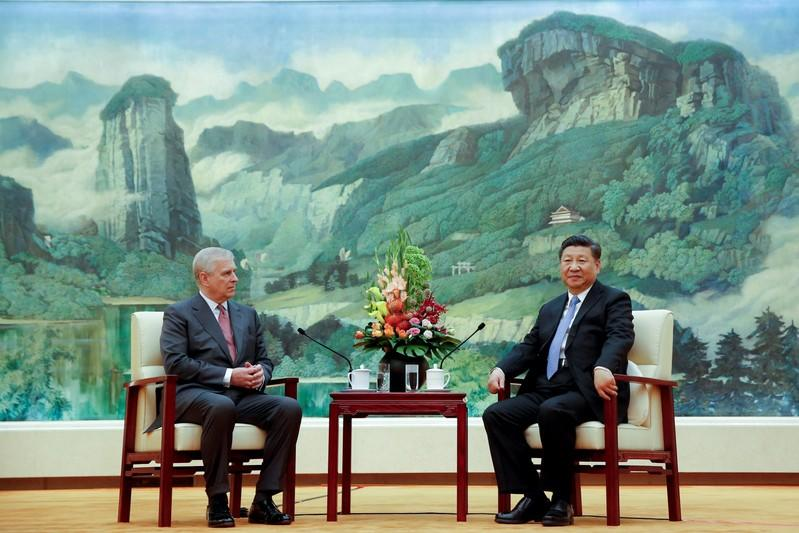 FILE PHOTO: Chinese President Xi Jinping meets Britain's Prince Andrew at the Great Hall of the People in Beijing