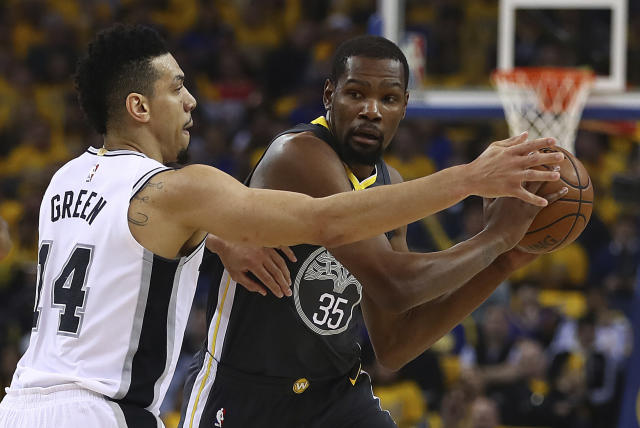 <p> Golden State Warriors' Kevin Durant (35) is guarded by San Antonio Spurs' Danny Green (14) during the first quarter in Game 2 of a first-round NBA basketball playoff series Monday, April 16, 2018, in Oakland, Calif. (AP Photo/Ben Margot) </p>