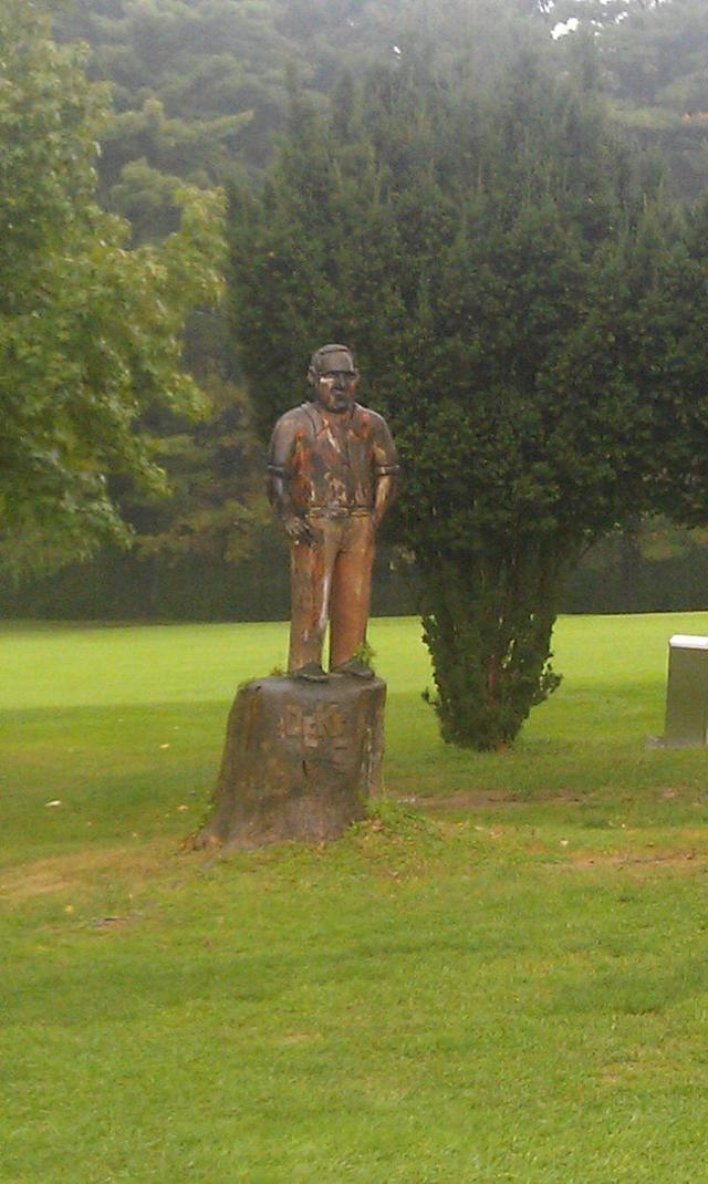 A wooden statue of Deacon Palmer at Latrobe Country Club. (Ryan Ballengee)