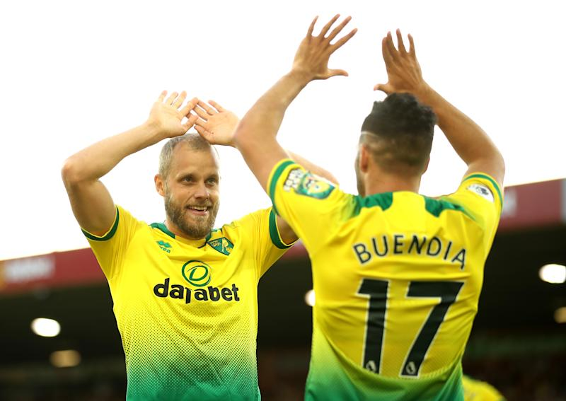 NORWICH, ENGLAND - SEPTEMBER 14: Teemu Pukki of Norwich City celebrates with teammate Emiliano Buendia of Norwich City after scoring his team's third goal during the Premier League match between Norwich City and Manchester City at Carrow Road on September 14, 2019 in Norwich, United Kingdom. (Photo by Marc Atkins/Getty Images)
