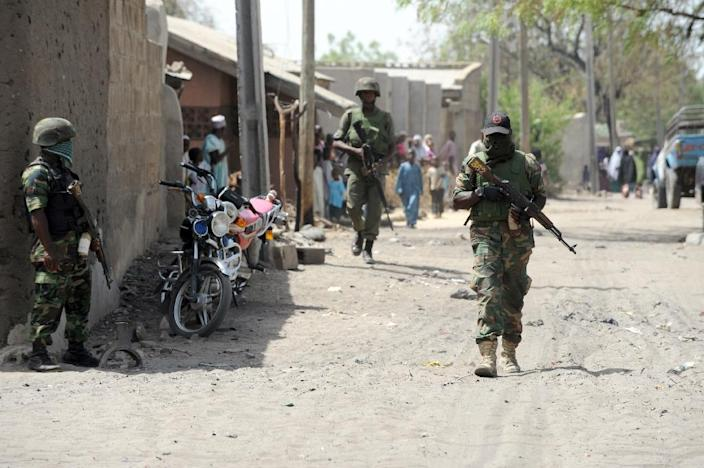 Soldiers walking in the street in the remote northeast town of Baga, Borno State, Nigeria, on April 30, 2013 (AFP Photo/Pius Utomi Ekpei)