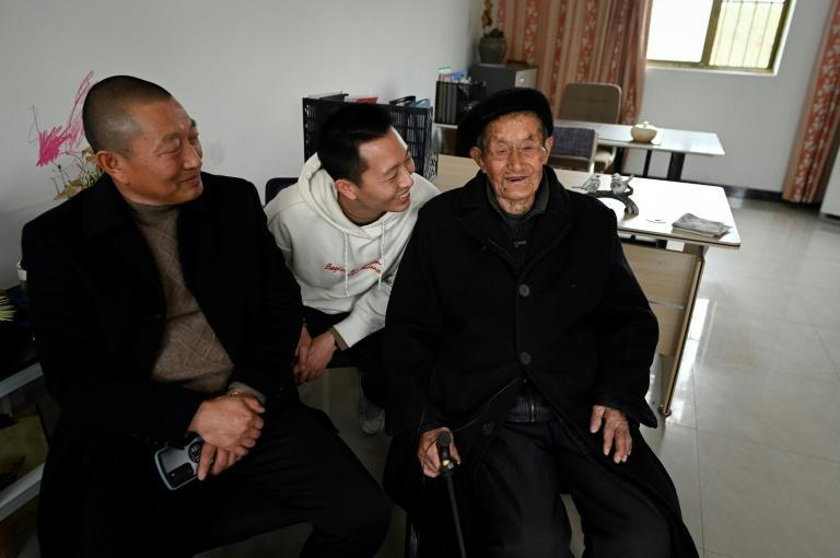 Qian Zuhua (R), 101, still works at his son's screw production factory, matching metal nuts and bolts with his nimble fingers