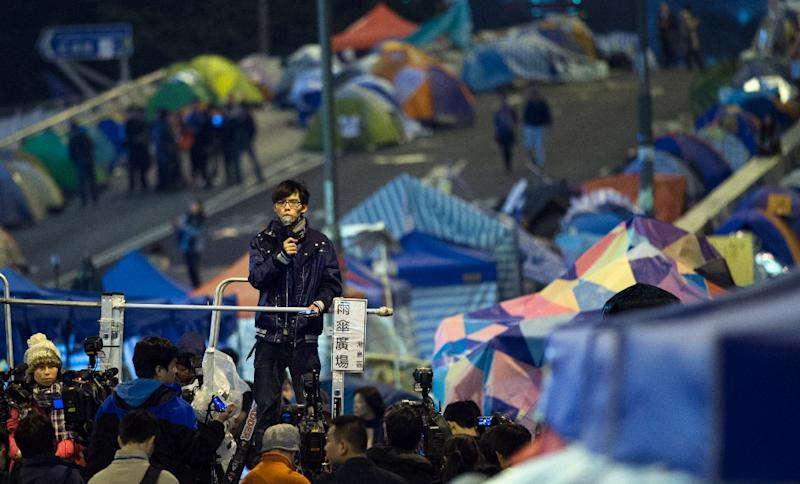 Student leader Joshua Wong addresses pro-democracy protestors in Hong Kong's Admiralty district on December 6, 2014 (AFP Photo/Johannes Eisele)