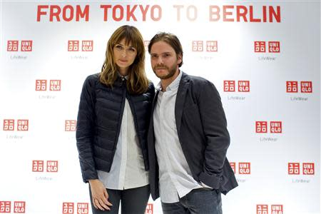 German model Eva Padberg and German Actor Daniel Bruehl pose in the Uniqlo Global flagship store during a preopening in Berlin, April 10, 2014. REUTERS/Axel Schmidt