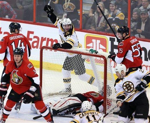 Boston Bruins Daniel Paille celebrates a goal during the first period of an NHL hockey game against the Ottawa Senators on Monday, March 11, 2013, in Ottawa, Ontario. (AP Photo/The Canadian Press, Fred Chartrand)