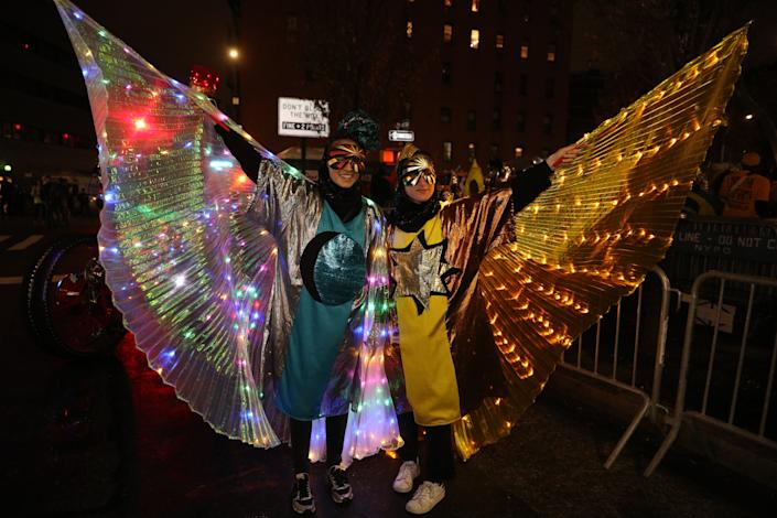 Revelers wearing colorful costumes march in the Halloween Parade in New York. (Photo: Gordon Donovan/Yahoo News)