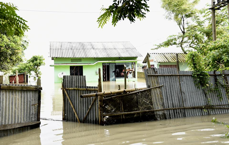 A house partially submerged by flood water, in Panikhaiti village, in Kamrup District, Assam, India on Tuesday, on July 14, 2020. Villages in Assam were flooded due to heavy rains. The rising water level inundated houses, residents were forced to move to a safer place. (Photo by Hafiz Ahmed/Anadolu Agency via Getty Images)