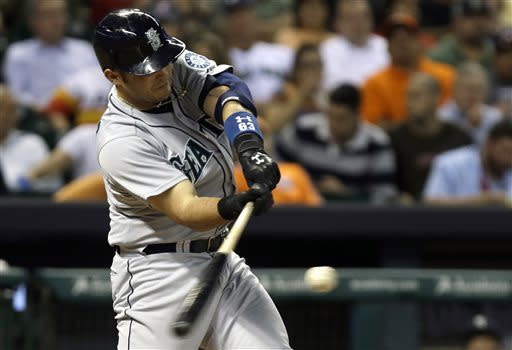 Seattle Mariners' Jesus Montero hits a two-run home run against the Houston Astros in the fourth inning of a baseball game Monday, April 22, 2013, in Houston. (AP Photo/Pat Sullivan)