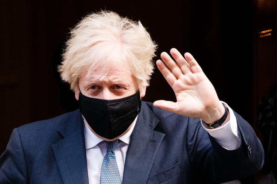 British Prime Minister Boris Johnson, Conservative Party leader and MP for Uxbridge and South Ruislip, wears a face mask leaving 10 Downing Street to head to Parliament in London, England, on January 6, 2021. MPs vote today on whether to approve the England-wide coronavirus lockdown announced by the prime minister on Monday night. (Photo by David Cliff/NurPhoto via Getty Images)