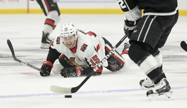 Ottawa Senators left wing Zack Smith, left, watches Los Angeles Kings left wing Carl Hagelin take the puck after he fell during the first period of an NHL hockey game Thursday, Jan. 10, 2019, in Los Angeles. (AP Photo/Mark J. Terrill)