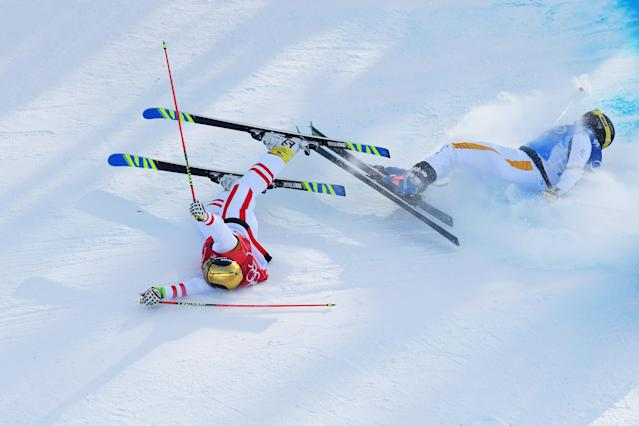 <p>Christoph Wahrestoetter of Austria, Erik Mobaerg of Sweden crash in the Freestyle Skiing Men's Ski Cross 1/8 finals on day 12 of the PyeongChang 2018 Winter Olympic Games at Phoenix Snow Park on February 21, 2018 in Pyeongchang-gun, South Korea. (Photo by Quinn Rooney/Getty Images) </p>