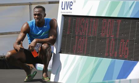 """Jamaican Olympic gold medallist Bolt poses after winning the """"Mano a Mano"""" men's 100 metres challenge in Rio de Janeiro"""