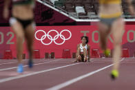 Katarina Johnson-Thompson, of Britain, reacts after dropping to the track during a heat in the heptathlon women's 200-meter at the 2020 Summer Olympics, Wednesday, Aug. 4, 2021, in Tokyo. (AP Photo/Petr David Josek)