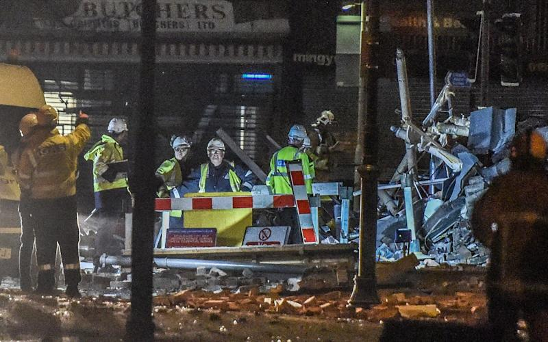 Emergency workers at the scene of the gas blast - Credit:  Iain Watts/Mercury Press