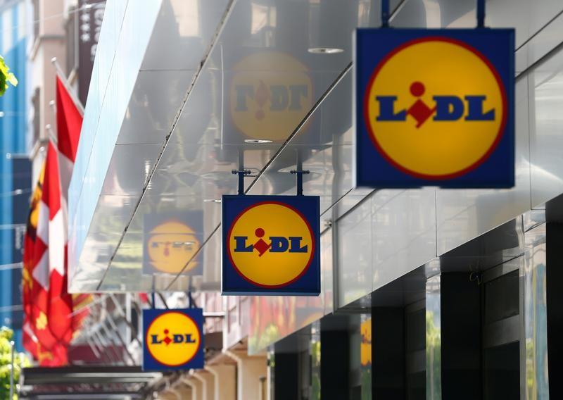 Logos are pictured outside a Lidl retail shop in Geneva