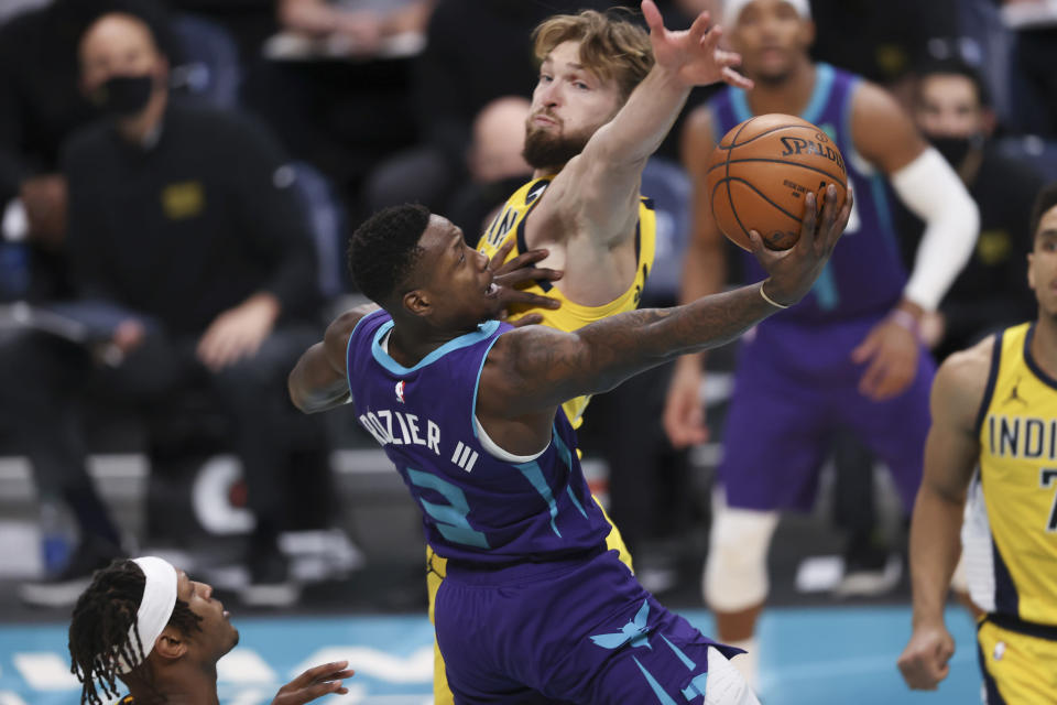 Charlotte Hornets guard Terry Rozier drives to the basket against Indiana Pacers forward Domantas Sabonis during the second half of an NBA basketball game in Charlotte, N.C., Wednesday, Jan. 27, 2021. (AP Photo/Nell Redmond)