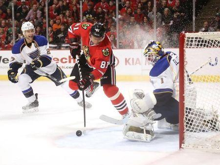 Apr 6, 2014; Chicago, IL, USA; Chicago Blackhawks right wing Marian Hossa (81) shoots on St. Louis Blues goalie Brian Elliott (1) during the first period at the United Center. Dennis Wierzbicki-USA TODAY Sports
