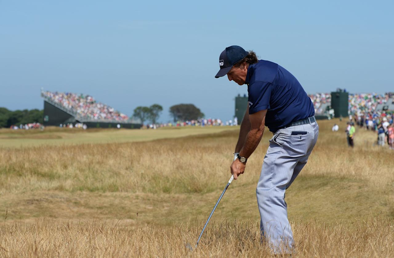 GULLANE, SCOTLAND - JULY 20: Phil Mickelson of the United States hits out of the rough on the 5th hole uring the third round of the 142nd Open Championship at Muirfield on July 20, 2013 in Gullane, Scotland. (Photo by Stuart Franklin/Getty Images)