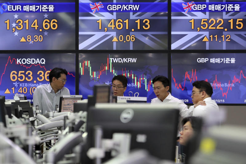 Currency traders work at the foreign exchange dealing room of the KEB Hana Bank headquarters in Seoul, South Korea, Thursday, Oct. 17, 2019. Asian shares were mixed Thursday after officials signaled work remains to be done on an agreement for a truce in the tariff war between the U.S. and China. (AP Photo/Ahn Young-joon)