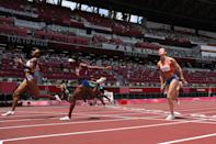 <p>Jasmine Camacho-Quinn of Team Puerto Rico wins the gold medal, Kendra Harrison of Team United States wins the silver medal and Megan Tapper of Team Jamaica wins the bronze medal in the Women's 100m Hurdles Final on day ten of the Tokyo 2020 Olympic Games at Olympic Stadium on August 02, 2021 in Tokyo, Japan. (Photo by Christian Petersen/Getty Images)</p>