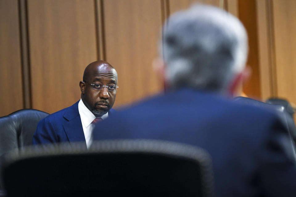 Sen. Raphael Warnock, D-Ga., questions Federal Reserve Chairman Jerome Powell during a Senate Banking, Housing and Urban Affairs Committee hearing on the CARES Act on Capitol Hill, Tuesday, Sept. 28, 2021 in Washington. (Matt McClain/The Washington Post via AP, Pool)