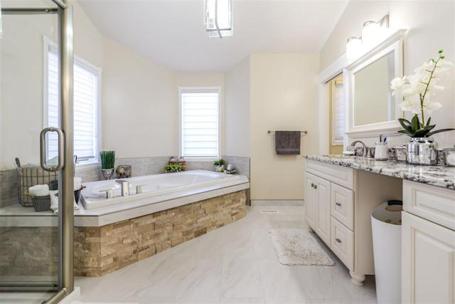 <p><span>158 Wolf Ridge Place Northwest, Edmonton, Alta.</span><br> The master ensuite has a soaker tub, rain shower and double vanity.<br> (Photo: Zoocasa) </p>
