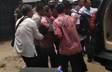 Indonesia's Chief Security Minister Wiranto is being carried from a car to emergency room after he was attacked in Pandeglang