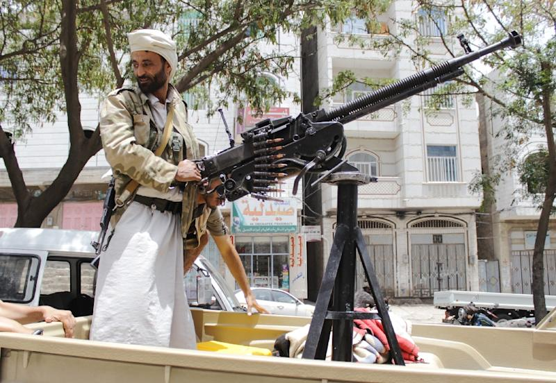 An armed Yemeni tribal gunman of the Popular Resistance Committees, loyal to fugitive President Abedrabbo Mansour Hadi, pictured on a street in the southern city of Taez in May (AFP Photo/Abdel Rahman Abdallah)