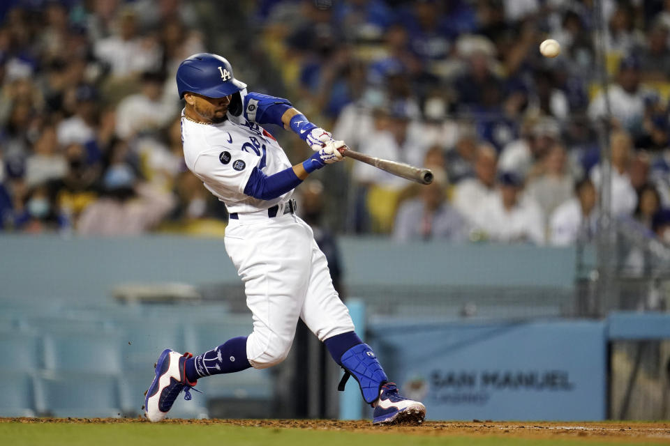 Los Angeles Dodgers' Mookie Betts connects for a solo home run during the third inning of a baseball game against the Atlanta Braves, Monday, Aug. 30, 2021, in Los Angeles. (AP Photo/Marcio Jose Sanchez)