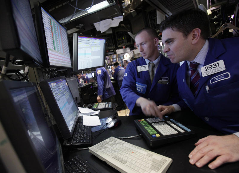 Specialists James Ahrens, left, and Robert Tuccillo work on the floor of the New York Stock Exchange Tuesday, Feb. 28, 2012. The Dow Jones industrial average closed above 13,000 Tuesday, the first time since May 2008, four months before the financial crisis. (AP Photo/Richard Drew)