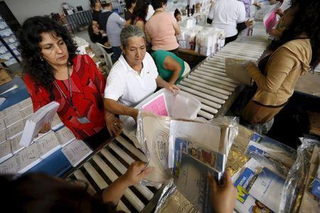 Employees pack electoral material and ballots in boxes, which will be distributed throughout the country, at a warehouse in Guatemala City October 21, 2015. REUTERS/Jorge Dan Lopez