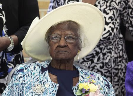 Jeralean Talley sits at the head table during a celebration of her 115th birthday at the New Jerusalem Missionary Baptist Church in Inkster,  Michigan in this file photo taken May 25, 2014. REUTERS/Rebecca Cook/Files