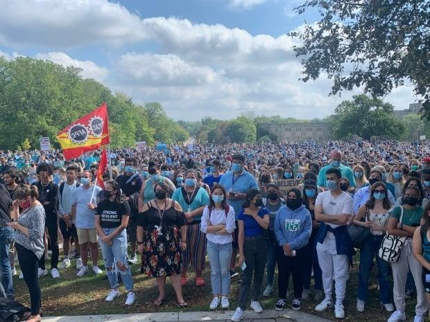 Thousands of Western University students came from across campus to protest on University College Hill, walking out of classes Friday to demand the London, Ont., school take action to end sexual violence and support survivors.  (Kate Dubinski/CBC - image credit)