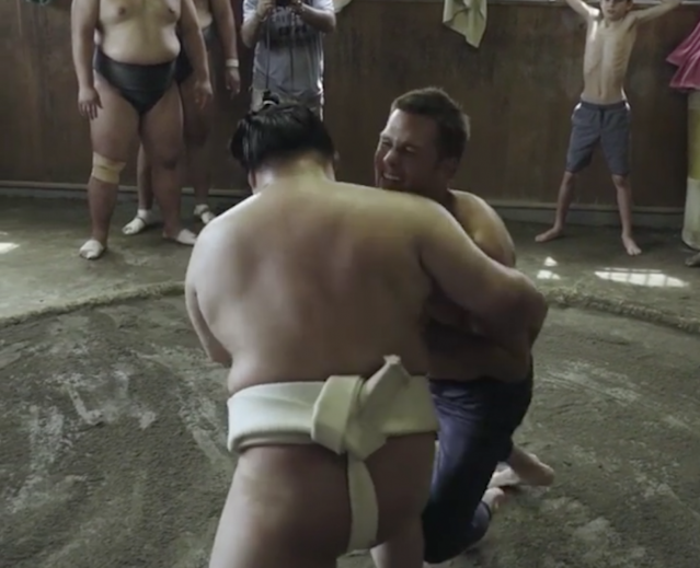 Tom Brady (right) has trouble with a sumo wrestler. (via Instagram)