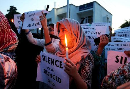 Students participate in a candle light procession as they protest against the rape and murder of an eight-year-old girl in Kathua, in Jammu, April 13, 2018. REUTERS/Mukesh Gupta