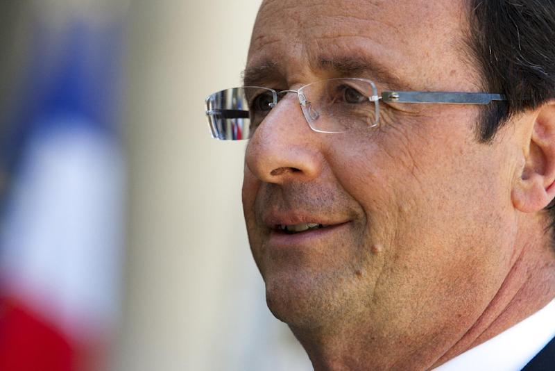French President, Francois Hollande reacts to media with Andorra's Prime Minister, Antoni Marti Petit, unseen, at the Elysee Palace, Paris, Thursday, July 26, 2012. (AP Photo/Jacques Brinon)
